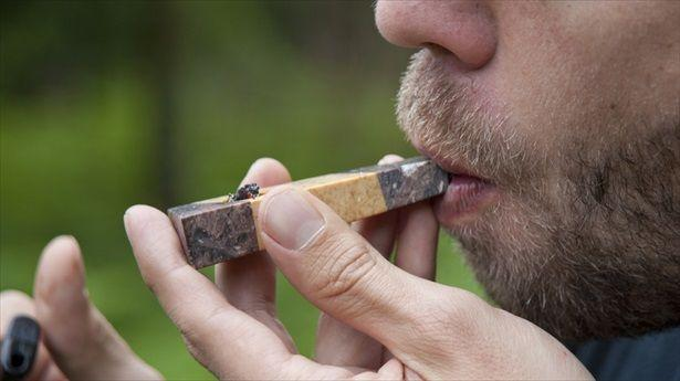 Man-smoking-marijuana-pipe-Shutterstock