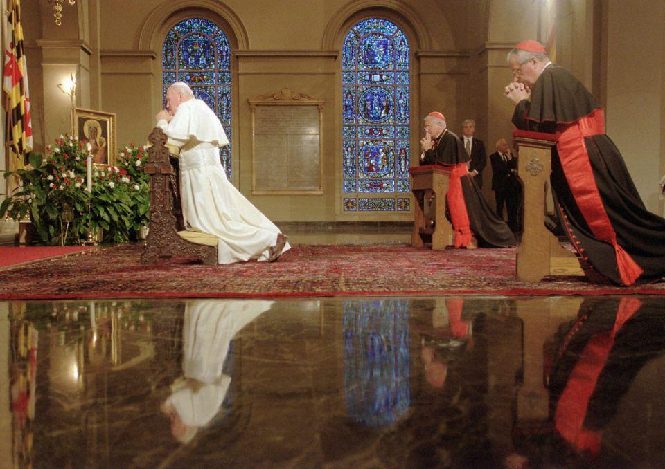 Pope John Paul II prays at the Basilica of the Assumption during a visit to Baltimore in 1995. AmericaÕs first cathedral was designed by Benjamin H. Latrobe, the architect of the U. S. Capitol. (Chiaki Kawajiri/Baltimore Sun)