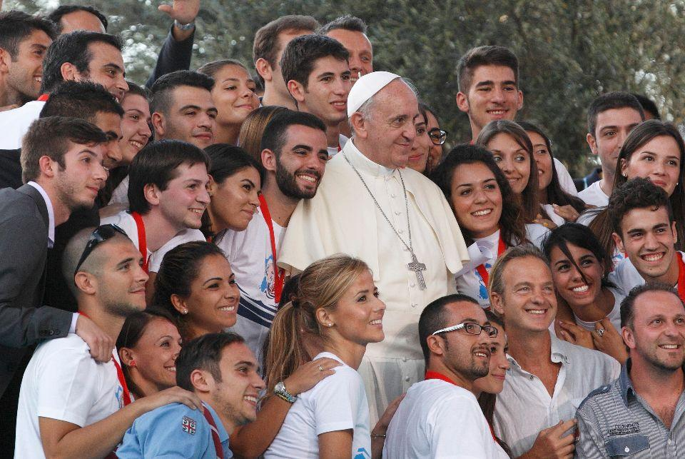 Pope Francis poses with young people during an encounter with youth in Cagliari, Sardinia, Sept. 22. (CNS photo/Paul Haring) (Sept. 23, 2013) See POPE-SARDINIA Sept. 23, 2013.