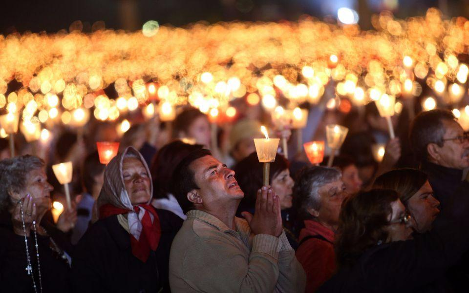 Worshippers pray during a candle light vigil at the Our Lady of Fatima shrine, in Fatima, central Portugal, Tuesday, May 12, 2015. Every year on May 12 and 13 tens of thousands of Catholic believers go on pilgrimage to the Fatima's sanctuary to pray and attend masses where the Virgin Mary is believed to be witnessed by three shepherds children Lucia, Jacinta and Francisco in 1917. (AP Photo/Francisco Seco)
